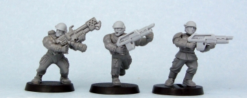 L to R: Catachan w/ Mad Robot head, Catachan w/ Mad Robot head and pulse rifle, Cadian w/ Mad Robot head and pulse rifle