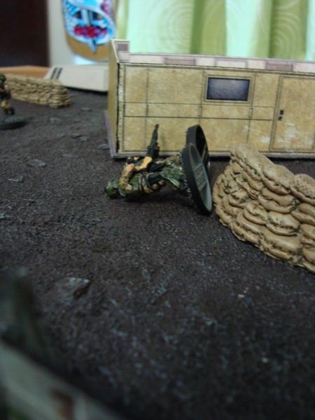 The machinegun in the tower guns down Bruce and Swartz