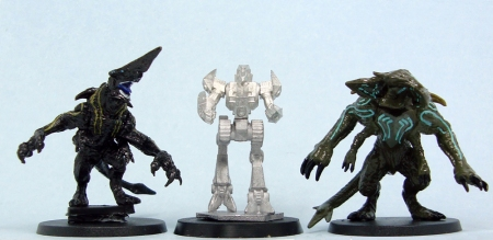 L to R: Heroclix Knifehead, Spitfire, Heroclix Scunner