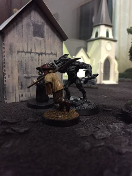 The werewolf goes after the priest and a villager