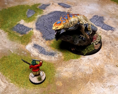 Scene of lizard threatening pirate miniature